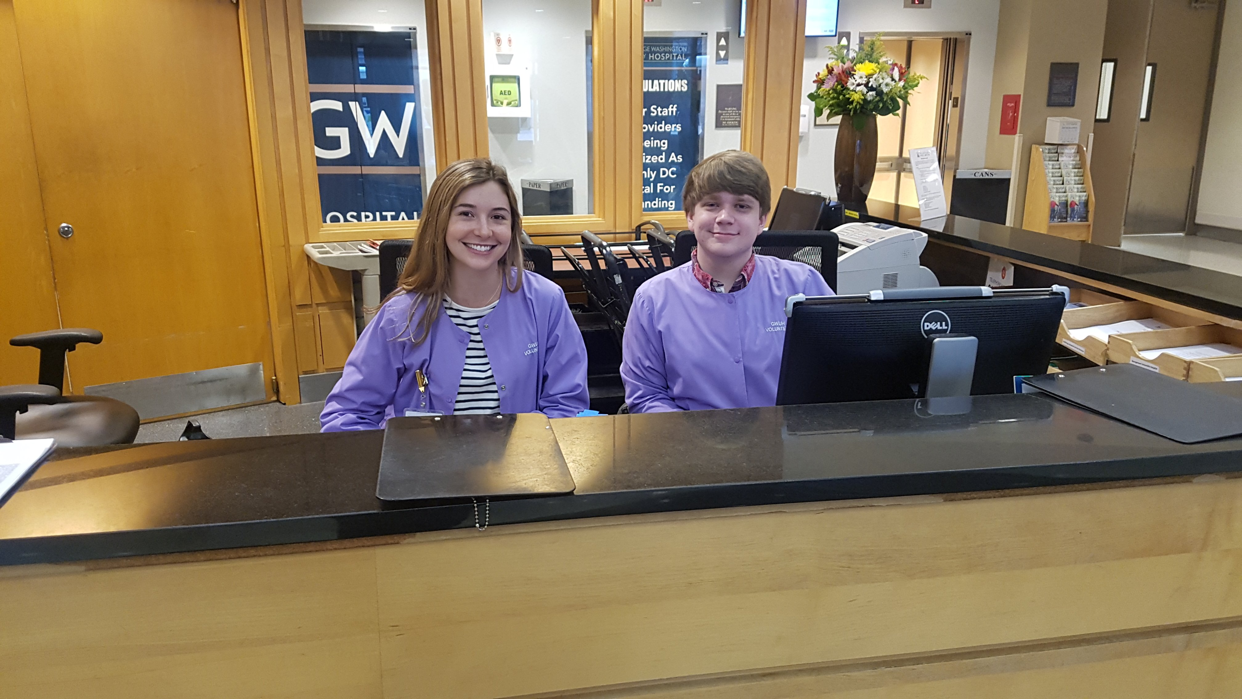 Volunteers Working At The GW  Hospital Reception Desk