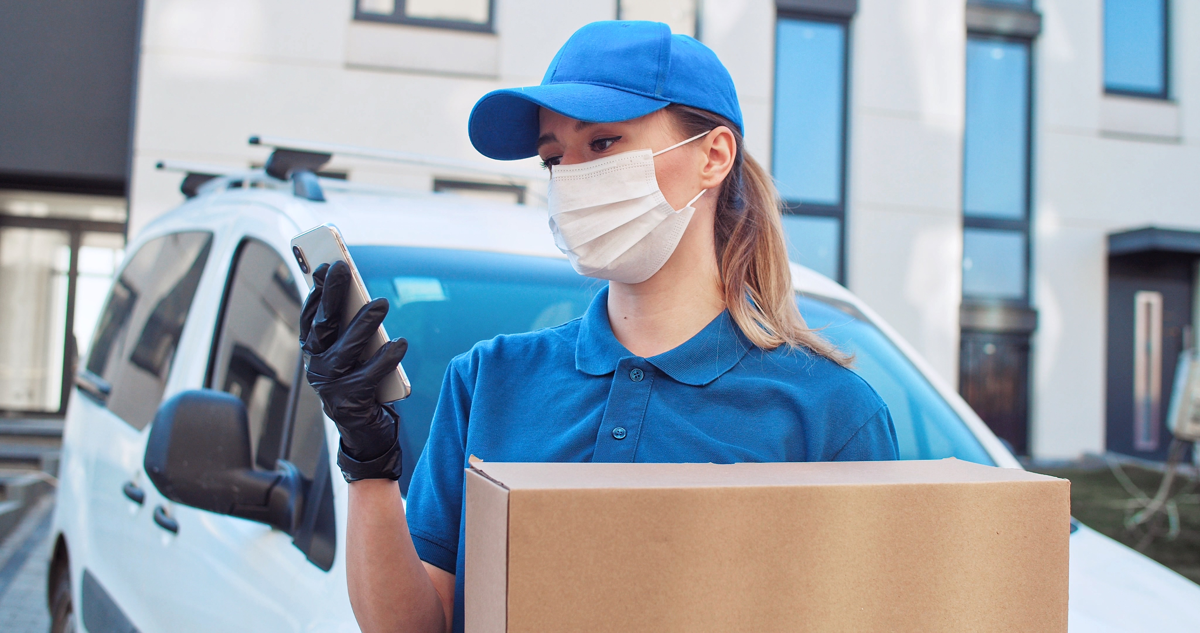 close-up-portrait-woman-package-delivery-courier-person-giving-package-wearing-blue-uniform-giving_t20_0X81WV